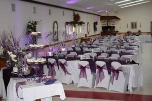 Banquet hall wedding side view with cake table