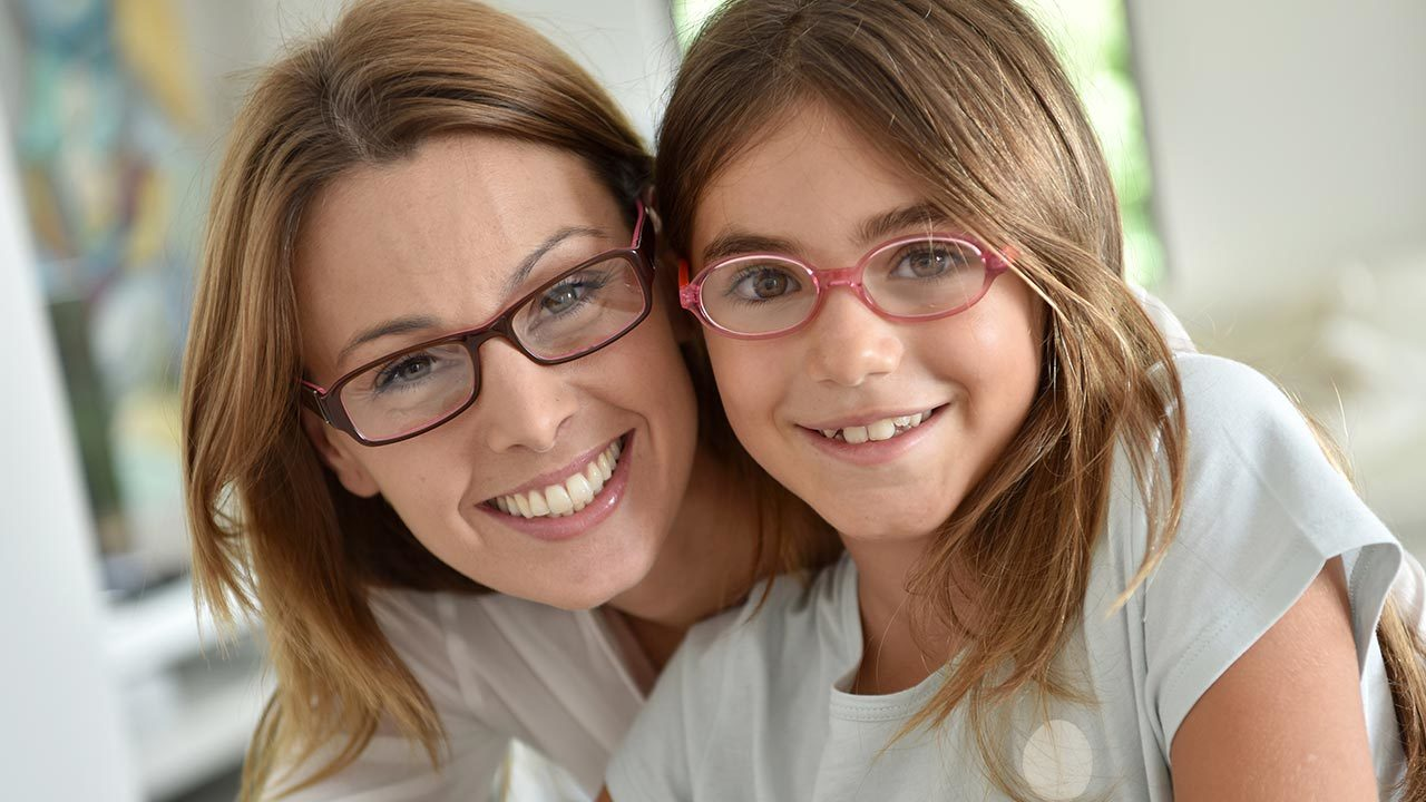 Mother daughter wearing glasses